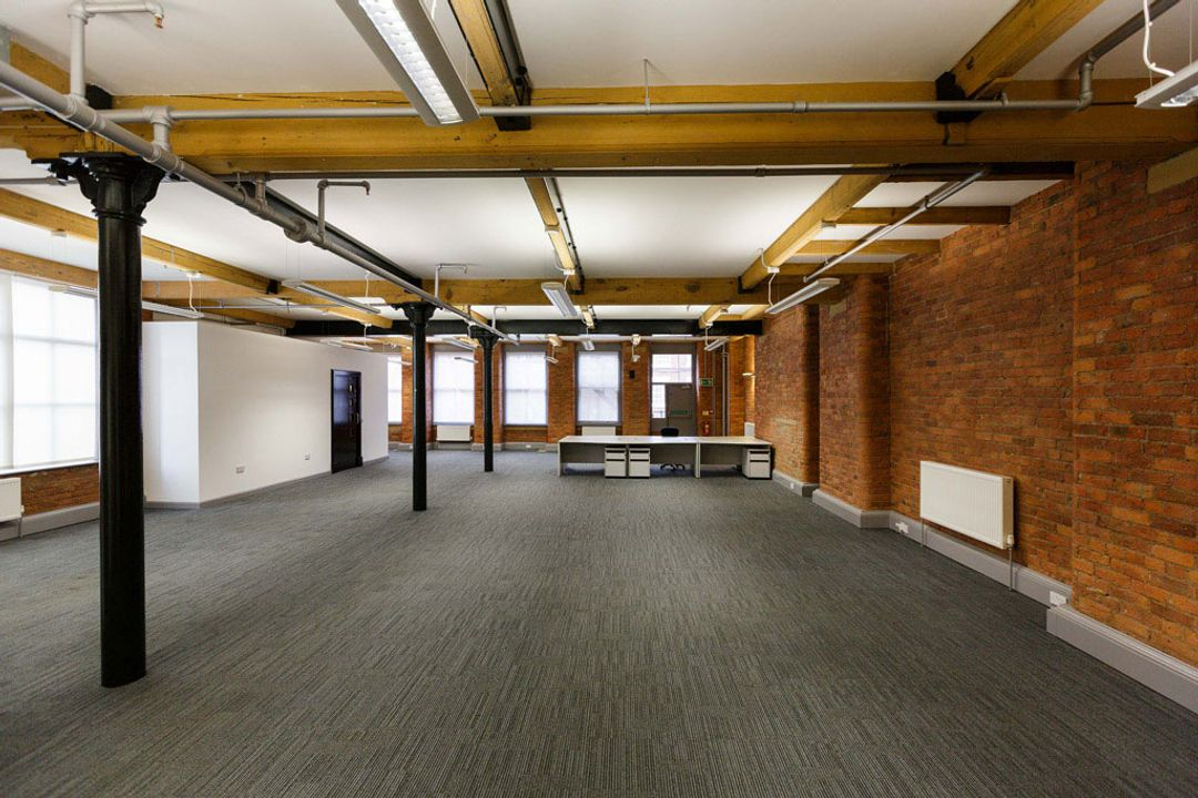Buffalo 7 - Office space before fit out and furniture installation. Showing length view of empty office space