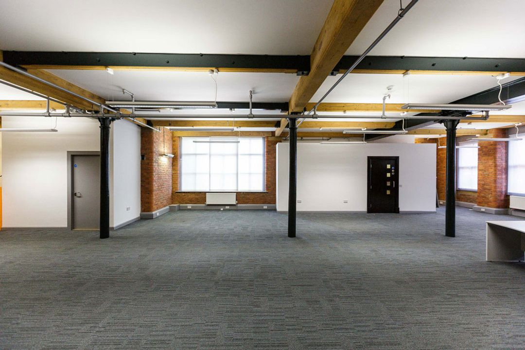 Buffalo 7 - Office space before fit out and furniture installation. Showing north facing view of empty space