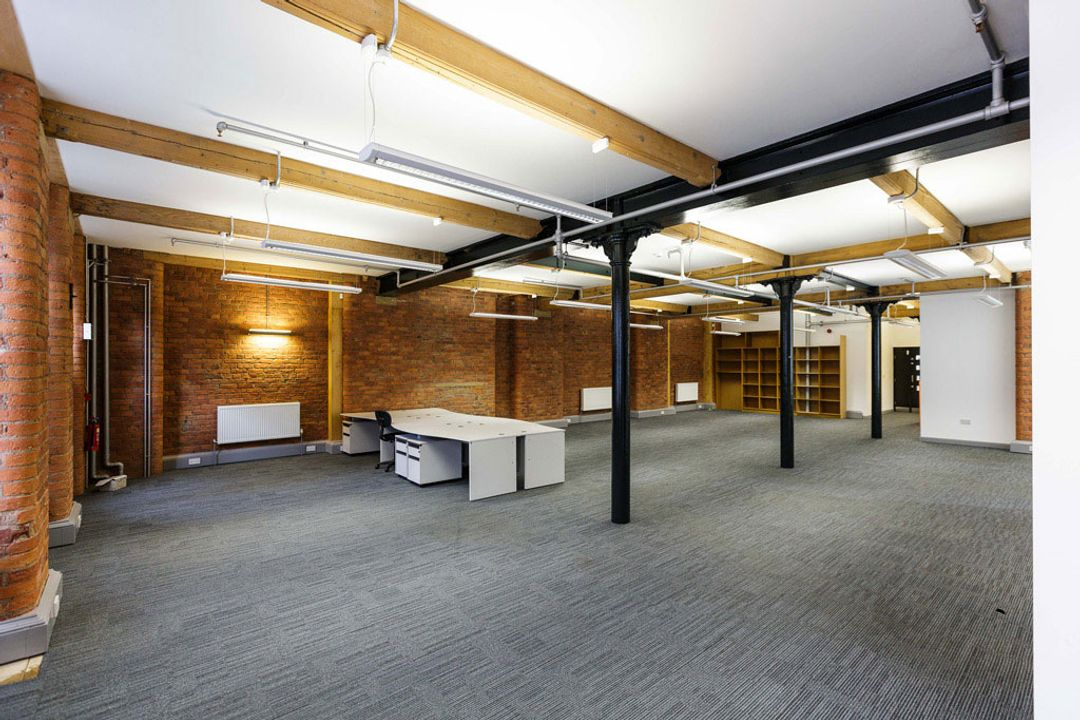 Buffalo 7 - Office space before fit out and furniture installation. Showing view of dark cast iron supports