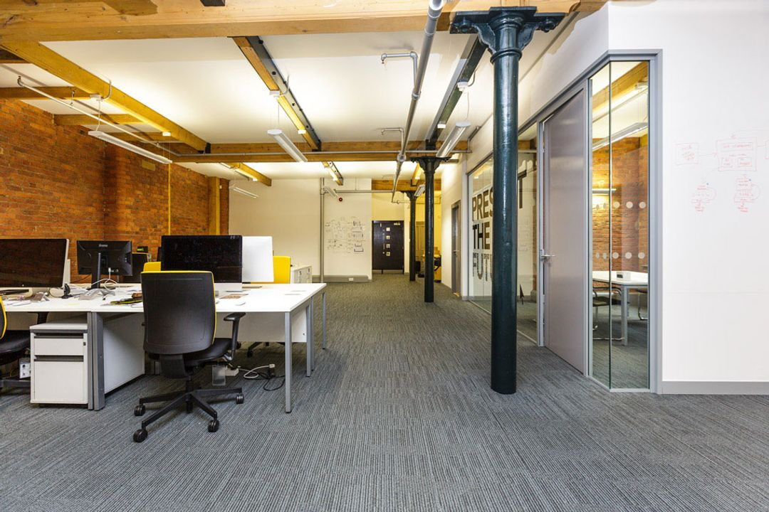Buffalo 7 - Office space After fit out and furniture installation. Showing full length view of main office