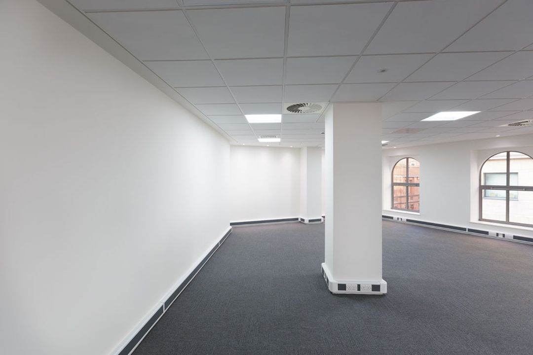 A blank canvas wall before the Spatial Office fit out of Premier Group, Manchester