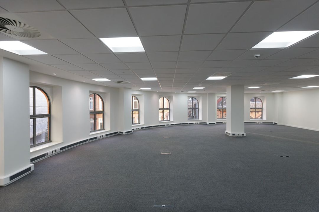 The east facing wall of an empty office space before the Spatial Office fit out for Premier Group, Manchester