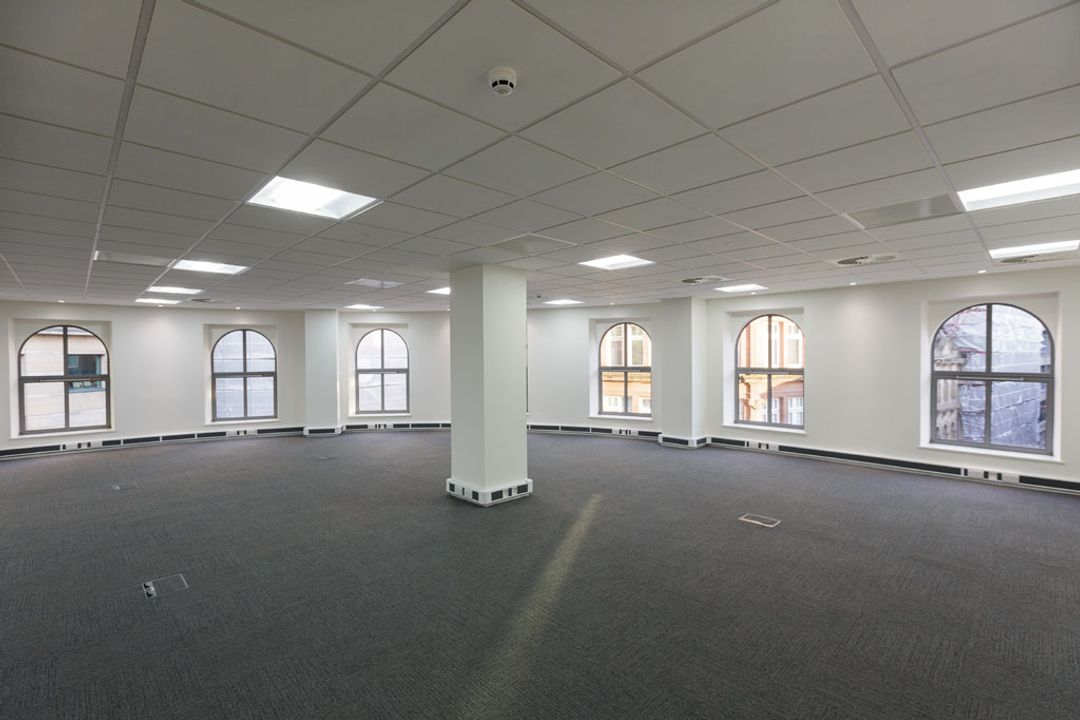 The north east corner of an empty office space before the Spatial Office fit out for Premier Group, Manchester